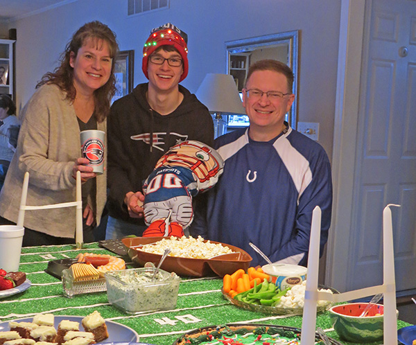 Host parents and exchange student during super bowl